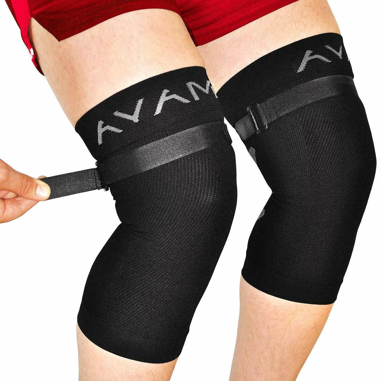 sports knee brace pair with adjustable strap