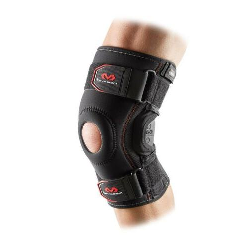 knee brace with polycentric hinges and cross